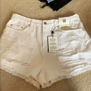 Size 10 white high waisted ripped shorts
